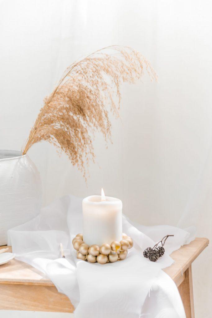 DIY Kerzenuntersetzer aus Murmeln in gold